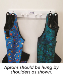 aprons hanging from rack
